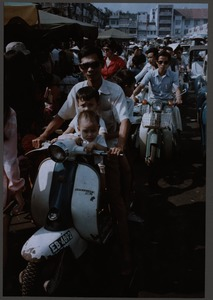 Thumbnail of Father and sons on a scooter