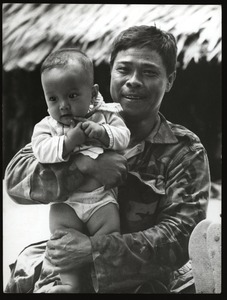 Thumbnail of Soldier father with infant son