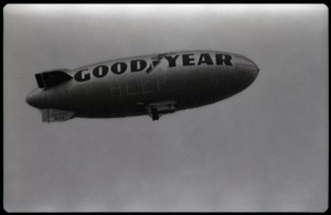Thumbnail of Beatles concert at Shea Stadium: Goodyear blimp floating over the stadium with             lights lit up spelling 'Help'