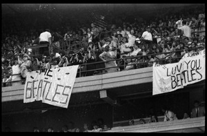 Thumbnail of Beatles concert at Shea Stadium: fans packed into the upper deck of the stadium             before the concert with banners reading 'The Beatles' and 'Luv you Beatles'