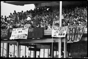 Thumbnail of Beatles concert at Shea Stadium: Beatles fans packed in the upper deck, with             banners reading 'We can't hear or see you, but we luv ya anyhow'