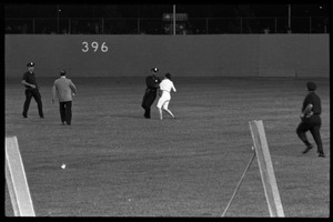 Thumbnail of Beatles concert at Shea Stadium: police grabbing a Beatles fan running onto the outfield grass