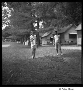 Thumbnail of Camp Arcadia: campers playing horseshoes in front of the cabins