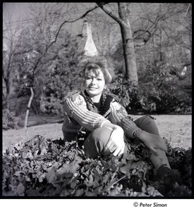Thumbnail of Joanna Simon sitting in a pile of leaves