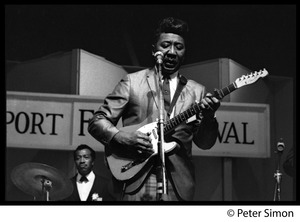 Thumbnail of Muddy Waters performing at the Newport Folk Festival Francis Clay (drums) in background