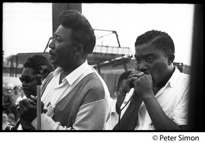 Thumbnail of Muddy Waters Blues Band performing at the Newport Folk Festival L. to r.: Francis Clay (bass), Muddy Waters, Mojo Buford (harmonica)