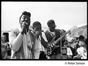 Thumbnail of Muddy Waters Blues Band performing at the Newport Folk Festival L. to r.: Muddy Waters, Mojo Buford (harmonica), and Luther 'Georgia Boy' Johnson (guitar)