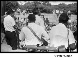 Thumbnail of Rear of stage view of Muddy Waters Blues Band performing at the Newport Folk Festival L. to r.: Mojo Buford (harmonica), Sammy Lawhorn (guitar), Muddy Waters             (vocals), Francis Clay (bass)