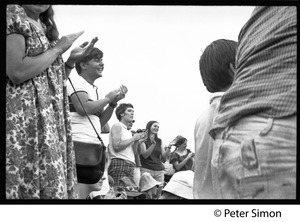 Thumbnail of Audience applauding Buffy Sainte-Marie at the Newport Folk Festival
