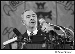 Thumbnail of Presidential candidate Eugene McCarthy on stage, giving a speech at Boston             University in front of a large BU banner