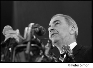 Thumbnail of Presidential candidate Eugene McCarthy behind microphones, looking up, while giving a speech at Boston University