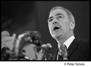 Thumbnail of Presidential candidate Eugene McCarthy behind a bank of microphones, giving a speech at Boston University