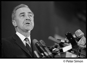 Thumbnail of Presidential candidate Eugene McCarthy behind a bank of microphones giving a speech at Boston University