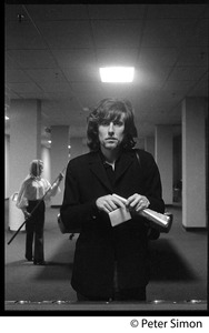 Thumbnail of Graham Nash in a pool hall: three-quarter length portrait facing the camera