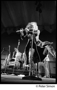 Thumbnail of Ian Anderson (Jethro Tull) dancing and playing flute (full-length portrait), Newport Jazz Festival