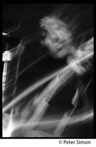 Thumbnail of Tim Buckley in performance, probably at the Unicorn Coffee House Close-up of Buckley playing guitar (image in motion blur)
