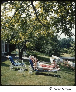 Thumbnail of Carly Simon with friends in lounge chairs