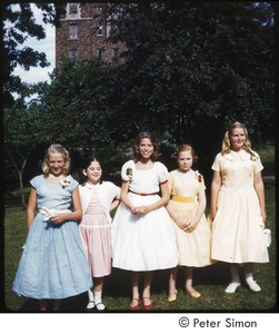 Thumbnail of Carly Simon (center) with girls in dresses