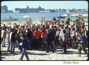 Thumbnail of MUSE concert and rally: crowd gathering by food carts, overlooking the Hudson River