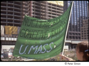 Thumbnail of MUSE concert and rally: demonstrator holding a 'U.Mass PIRG' banner