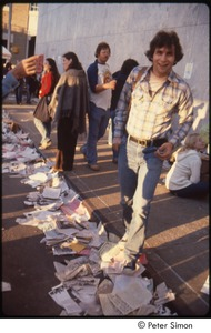 Thumbnail of MUSE concert and rally: man stepping off curb onto pile of litter