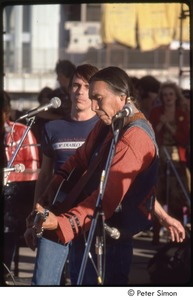 Thumbnail of MUSE concert and rally: unidentified Native American musician with Jackson Browne performing at the No Nukes rally