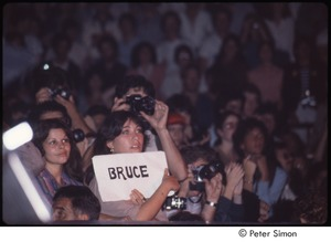 Thumbnail of MUSE concert and rally: audience at the MUSE concert, woman holding sign reading, 'Bruce'