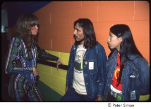 Thumbnail of MUSE concert and rally: Carly Simon, James Trudell, and an unidentified woman backstage at the MUSE concert