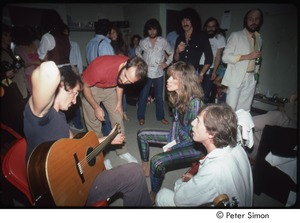 Thumbnail of MUSE concert and rally: James Taylor, John Hall, Carly Simon, and Graham Nash rehearse while group looks on backstage at the MUSE concert