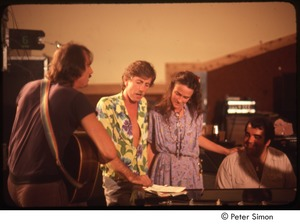 Thumbnail of MUSE concert and rally: (l-r) James Taylor, Graham Nash, unidentified woman, and Don Grolnick rehearsing