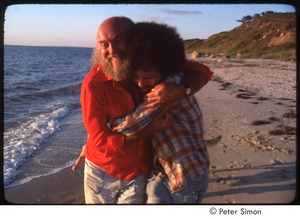 Thumbnail of Ram Dass embracing Daniel Goleman on the beach