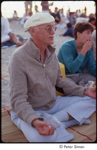 Thumbnail of Ram Dass posing in half lotus on the beach