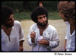 Thumbnail of Richard Wizansky (center) smoking a cigarette and talking with David Silver             (right), Tree Frog Farm commune