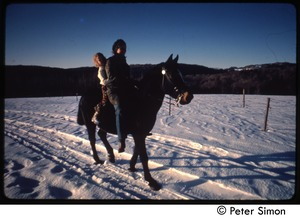 Thumbnail of Riding a horse through the snow, Tree Frog Farm commune