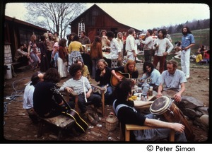 Thumbnail of Gathering with musical instruments at the May Day celebration, Packer Corners commune