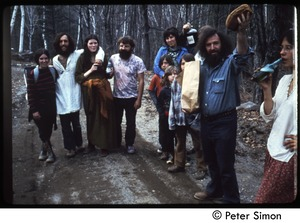Thumbnail of Commune members walking down a dirt road, Tree Frog Farm commune Includes (from left) Elliot Blinder (2nd) and Catherine Blinder (3d), Peggy             Braun (5th), Sol Braun (with bread), and Kiki McEntee (partially obscured)