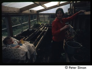 Thumbnail of Catherine Blinder and baby in green house, Tree Frog Farm commune