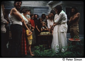 Thumbnail of Catherine and Elliot Blinder cutting the cake at their wedding, Tree Frog Farm commune