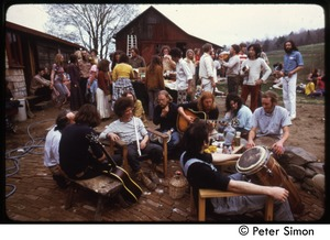 Thumbnail of Gathering with musical instruments at May Day celebration, Packer Corners commune