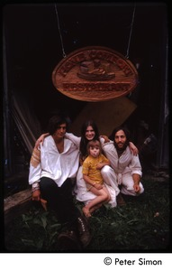 Thumbnail of Tim Rossner (?),Catherine Blinder, Elliot Blinder, and child seated under Home             Comfort Restaurant sign