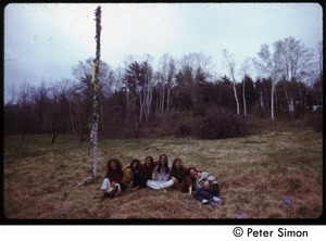 Thumbnail of Group of celebrants seated by the maypole, Tree Frog Farm Commune
