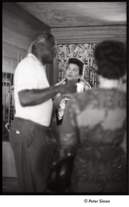 Thumbnail of Party at Jackie Robinson's house: Jackie Robinson speaking to a group of women