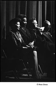 Thumbnail of Martin Luther King Jr. rally at the Fieldston School: Ossie Davis (second from left) with one unidentified woman and two unidentified men listening on stage