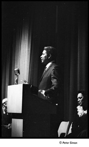 Thumbnail of Martin Luther King Jr. rally at the Fieldston School: Ossie Davis speaking, Ruby Dee seated on right