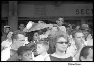Thumbnail of Mets at Shea Stadium: boy with his mother holding a banner