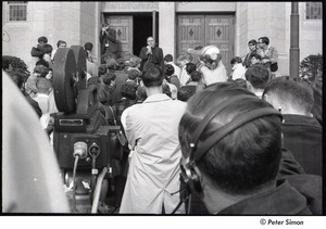 Thumbnail of Malcolm Boyd at Boston University: Boyd speaking to a group on steps of Marsh Chapel