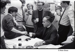 Thumbnail of Malcolm Boyd at Boston University: Boyd (seated) in the BU News room with (l-r) Richard Schweid, Raymond Mungo, Joe Pilati, an unidentified woman, and two unidentified men