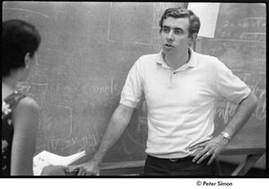 Thumbnail of National Student Association Congress: Sam Brown in front of a blackboard, speaking with a woman