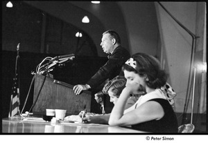 Thumbnail of National Student Association Congress: unidentified man at a podium, Sam Brown seated to his right