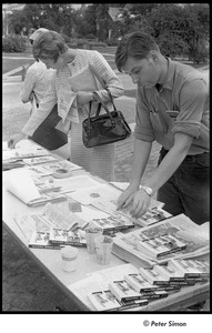 Thumbnail of National Student Association Congress: man and woman perusing new left literature